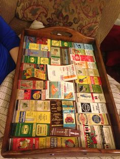 My tray of antique advertising matchbooks from mainly areas around my hometown. A piece of glass was later put over it to make it functional!