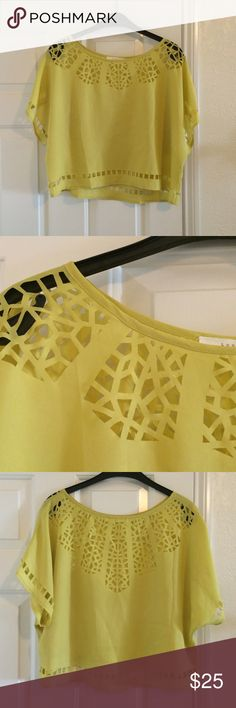 BNWOT Laser-cut design flowy top Bright yellow top with laser cut details along sleeves, neck, back, and bottom. Super fun and bold! Bought at really nice So Cal boutique Tops Blouses