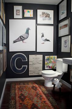 black walls with white art in powder room