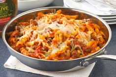 1 lb. (450 g) extra-lean ground beef 1 jar (700 mL) pasta sauce 2 cups water 3 cups penne pasta, uncooked 1 cup Kraft Part Skim Mozzarella Shredded Cheese