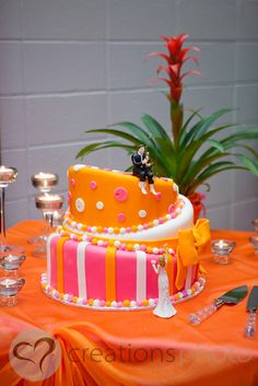 Brittany & Lee's topsy turvy wedding cake - the pink, white and orange look awesome here! - Creationsphoto