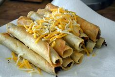 Taquitos recipe.  I am thinking fill it with ground beef, fuller than these, and drizzle melted cheese on top.  Then maybe they'll be like high school Crispitos!  :)
