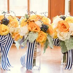 Many of the flower arrangements featured yellow and white flowers with navy blue accented ribbon to add a delicate touch to the color palette. Photo Credit: Stephanie Horwedel Photography