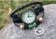 black leather bracelet watch http://www.aliexpress.com/store/product/Free-Shopping-Peace-symbol-black-leather-bracelet-watch-wholesale-fashion-personality-student-female-models/1196890_1786190399.html