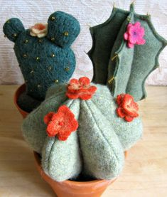 https://flic.kr/p/ffbdpH | new cactus group 1 | made from repurposed wool sweaters, stuffing and real clay pots, from FeltSewGood