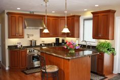 Traditional cherry kitchen with island