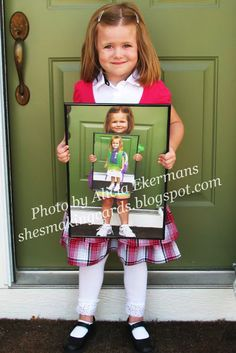 Each year, have your child hold the photo from the previous year. So cool!