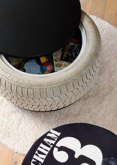 Tire toy box/storage container. All you need is a tire, paint and some wood. Genius!- would be awesome to do if we stick with the car theme for Korbyn