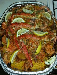 Seafood bake/boil with crab legs, shrimp, potatoes, and corn