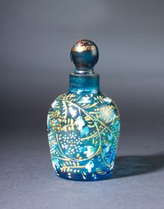 Moser Bohemian mini perfume bottle, circa 1900s, in turquoise crystal, with raised enamel details.