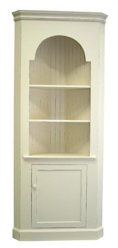 Add versatile storage to your cottage inspired kid's bedroom or playroom with the Corner Cupboard from Seabrook Classics. This corner storage unit with beadboard backing features two fixed shelves for storing books and games as well as a bottom one door cabinet