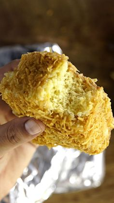 Recipe with video instructions: Crispy on the outside, and creamy on the inside, this tropical treat is a sweet dream come true. Ingredients: 1 egg, 1 cup sugar, 1 cup milk, divided (½ cup for sauce), ¾ cup pineapple juice concentrate, divided (¼ cup for sauce), ⅓ cup vegetable oil, 2 ½ cups white flour, ½ cup pineapple, chopped, 1 Tbsp baking powder, 1 (14 oz) can sweetened condensed milk, 3 cups toasted grated coconut