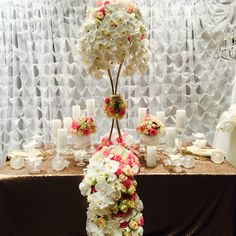 Decoritevents gold floral stands filled with roses and phalaenopsis. @decoritevents #centerpieces #weddingflowers #tablescape #weddings #linenhire #crystalcandlesticks #crystal #gold