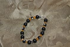 Black Millefiori Rounds, Black Glass Rounds, Yellow Glass Bicones, and Hematite Squares Bracelet