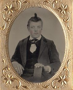 ca. 1860s, [hand tinted ambrotype portrait of a young man sporting a provocative hairstyle]