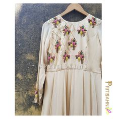 Flowers and the fenceOffwhite georgette floor length anarkali with floral colorful hand embroidery and criss cross detailingFor more information Whatsapp on 12 April 2018 New Kurti, Silk Kurti, Kurta Designs, Blouse Designs, Maggam Work Designs, Kurti Styles, Hand Embroidery Designs, Indian Ethnic Wear, Indian Designer Wear