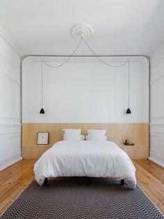 Clean, minimalist white bedroom architecture