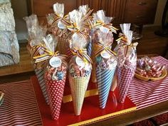 Wrapped popcorn cones as wedding favors. Guests can pick a cone, fill popcorn as they like, then wrap it all up!