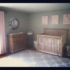 Pink and grey nursery. Great wood furniture.
