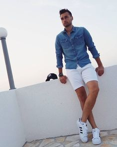simple summer style inspiration with a denim shirt white short low cut white socks white addias sneakers watch. Stylish Jeans, Stylish Mens Fashion, Denim Fashion, Fashion Sale, Fashion Outlet, Paris Fashion, Fashion Fashion, Runway Fashion, Look Short