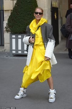 Having a fashion moment: Céline Dion, left Paris' Crillion hotel on Tuesday in yet another statement look, teaming a yellow anorak-style coat with a bizarre hybrid jacket Celine Dion, Style Finder, Hooded Dress, Character Costumes, Famous Celebrities, Hot Outfits, Costume Design, Celebrity Style, Street Style