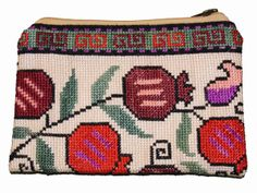 Past and present, east and west meet in the handmade stitches of Iroki, an ancient style of Uzbek embroidery. Iroki purses provide a beaut. Spotlights, Pomegranate, Women Empowerment, Clutches, Coin Purse, Presents, Meet, Embroidery, Stitch