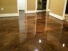 """This acid stained concrete floor looks like luxurious marble. Looks like """"acid stain"""" is the way to go."""