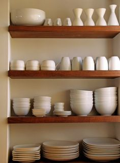not usually a fan of open shelving, but i could see having a small area with it like this. I prefer how this is built into a little nook.