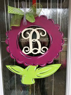 We love Spring! This is made from 1/4 in wood. It is hand painted. A wire hanger and bow is added. Mathis sign measures 19x22. We can change the colors if you would like. Just message us if you have a special request. Please add the letter in the note to seller box when ordering.