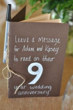 Table numbers in book form, something to read for each anniversary. I love this idea. Genius.: