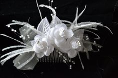 Three white roses with white pearl like centres. Surrounded by white decorative netting , white ostrich feathers and pearl star bursts. Ostrich Feathers, Hair Comb, White Roses, Pearl White, Special Occasion, Star, Pearls, Trending Outfits, Unique Jewelry