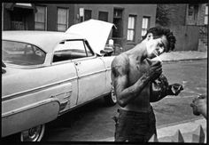 Shirtless Youth Lighting up Cigarette, Brooklyn New York, 1959 by Bruce Davidson.