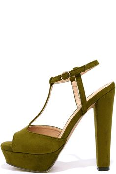 """Achieve the best seventies vibe around in the Go With the Throwback Olive Green T-Strap Platform Sandals! Olive green vegan suede shapes a peep-toe upper with T-strap and adjustable ankle strap (with gold buckle). 1.25"""" toe platform."""