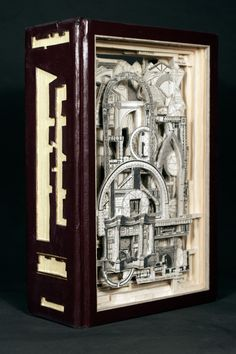 While I've seen other altered book art, most of it makes my skin crawl. I've been lusting over Brian Dettmer's works ever since I first saw it, though.