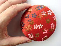 Orange fabric brooch made of Japanese kimono by japanmomijidesigns