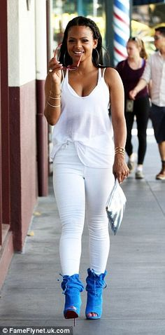 Double trouble: Christina Milian wore two very different looks on Friday in Los Angeles, C...