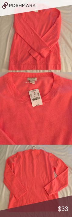 NWT J. Crew sweater top NWT J. Crew top. 45% cotton, 35% wool, 20% nylon. Machine wash dry flat. Color is a gorgeous pink orange. J. Crew Tops