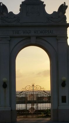 The closed an abandoned War Memorial of World War One in Oahu. Behind the gates is an Olympic pool and bleacher stands built in and from the ocean's water to honor 102 local heroes killed in the war.