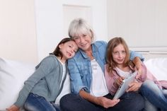 Grandmother with grandkids on a tablet