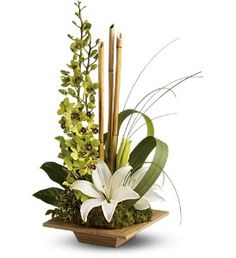 Dendrobium Orchids, Asiatic lilies, Aralia, Bamboo, Beargrass, reception wedding flowers,  wedding decor, wedding flower centerpiece, wedding flower arrangement, add pic source on comment and we will update it. www.myfloweraffair.com can create this beautiful wedding flower look.