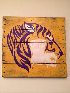 Tiger painted onto wooden board