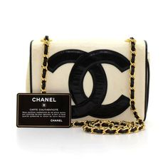 Authentic Chanel quilted mini shoulder bag in white leather with black leather piping. It has a flap top with CC magnetic lock on the front and 1 slip pocket on the back. Inside has white leather lining and 1 zipper pocket. Comfortably carried on shoulder. Very cute! #Chanel #Handbag @fmasarovic