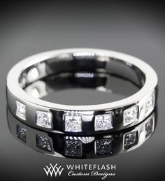 Men deserve diamonds too! This Platinum Wedding Band includes .30ctw in G/H color VS princess melee.