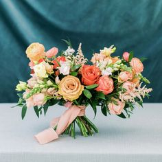 """A fun mix of soft peaches, blush, ivory and pops of coral. For the fun-loving, active and energetic couple. It's the perfect palette for Spring, Summer and Fall. Playful says, """"this is a celebration!"""