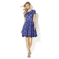 SHORT SLEEVE LACE DRESS    Beautiful blends of floral envelopes this Floral Print Dress from Vince Camuto. We love how the long length of this pronounced skirt balances out the sleeveless silhouette. This dress looks amazing with a thin waist belt for an attention grabbing pop of color. Pair yours with pair of crystal sandals.