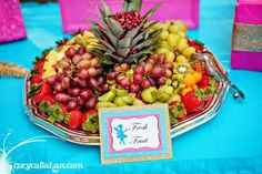 Fun fruit display .. love the pineapple top