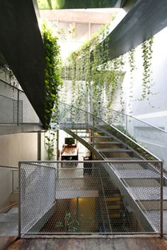 House N° 11 - The intertwining staircases act as a series of metal bridges—some straight, some curved, some kinked. The staircase balustrades are crafted from industrial mesh. Each flight is covered by a metal roof, upon which planters will be installed for plants, calling to mind a contemporary, scaled down Hanging Gardens.
