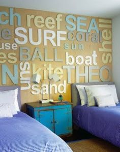 Love this shared Kids room with the wood word quotes on the wall