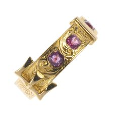 A very pretty late Victorian 15ct gold garnet buckle ring. The scroll engraved buckle, set at intervals with cushion-shape garnets.