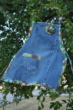 Aprons from jeans.  Great sewing idea.  this was sold on etsy no pattern. - It looks like she just cut open the leg of a pair of jeans, cut it into an apron shape, and edged it in bias tape. The pocket is great. Probably a back pocket removed and placed onto the apron. Fun! (I am soooo doing this!!!)